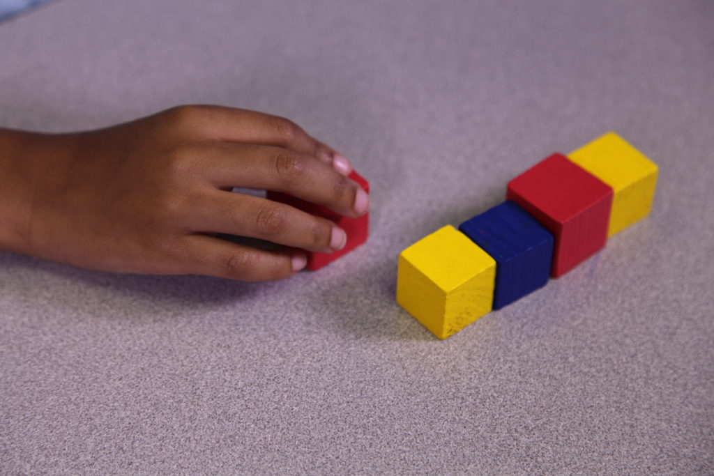 ABA Student using colored blocks