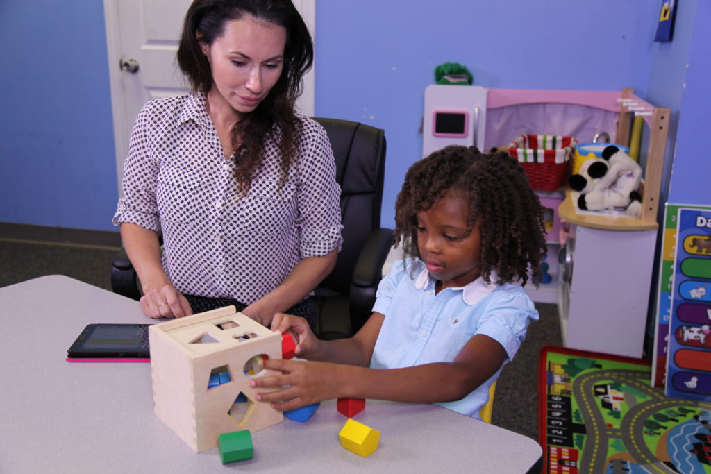 Special needs student using a shape sorter