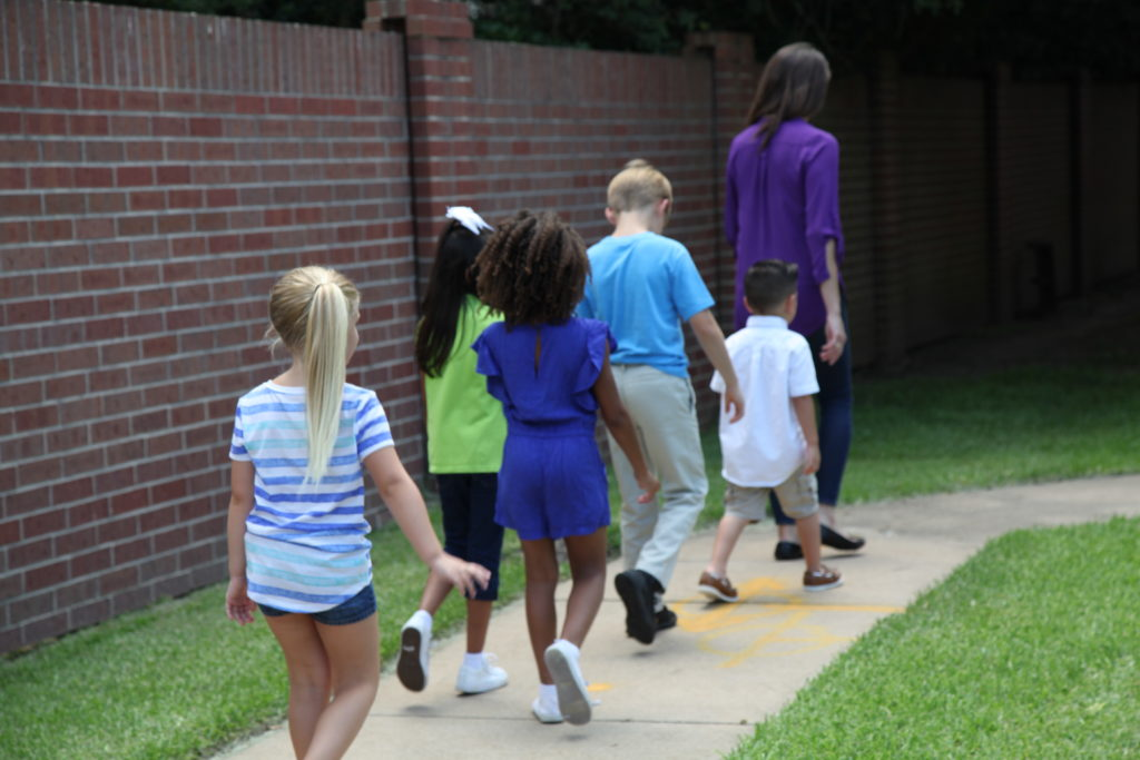 Special Needs Students walking with Teacher
